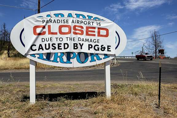 A banner blaming PG&E for the Paradise Airport closure is seen at Airport Road and Good View Drive, Friday, July 12, 2019, in Paradise, Calif. The town was damaged in the 2018 Camp Fire.