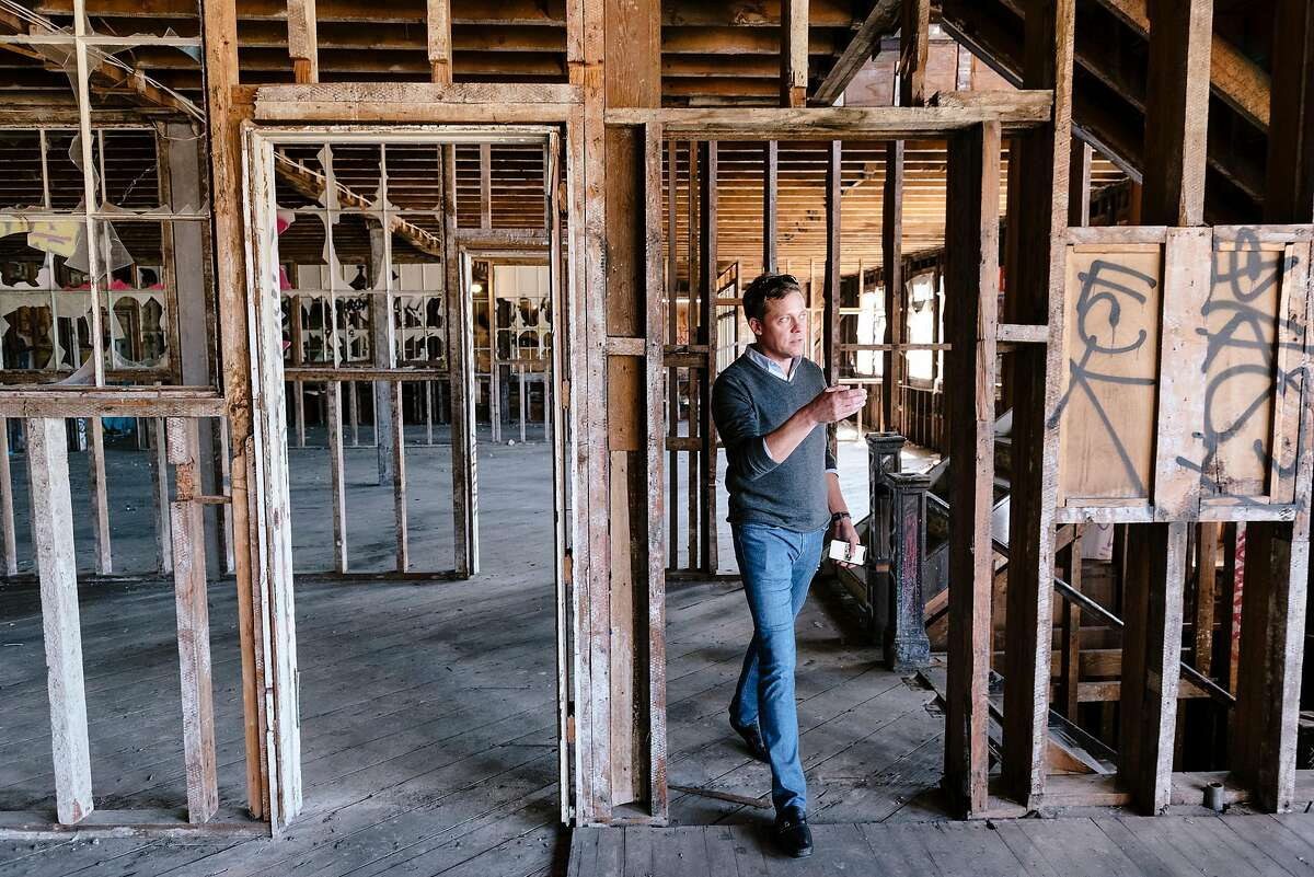Chris Leimbach, Universal Paragon Corporation's VP of Marketing and Sales, looks around the vacant Schlage Lock building during a tour of the upcoming Baylands development site near the Brisbane border in San Francisco, Calif. on Wednesday, Sept. 11, 2019.