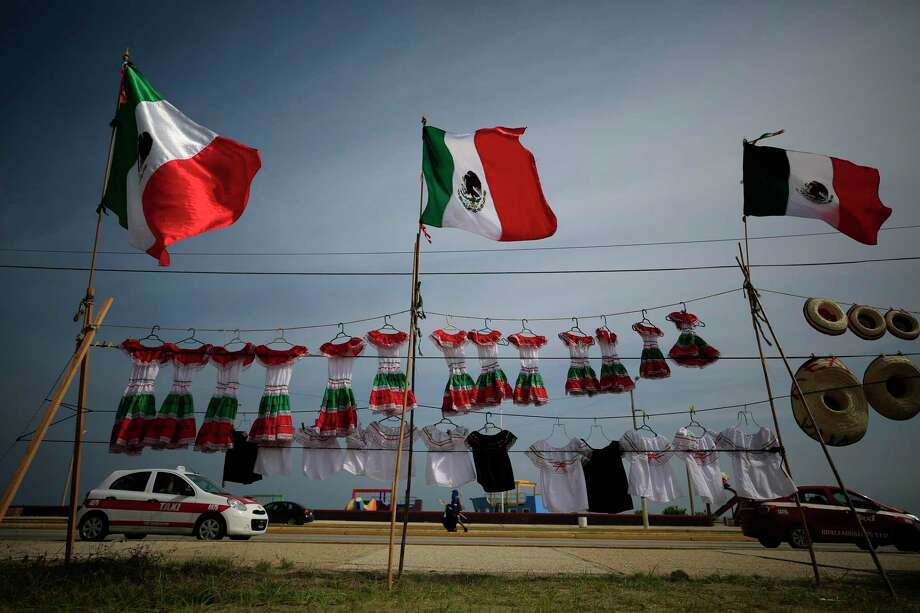 Just as Irish Americans celebrate St.  Patrick's Day, Mexican Americans have a cultural connection to Diez y Seis. Photo: Rebecca Blackwell /Associated Press / Copyright 2019 The Associated Press. All rights reserved.