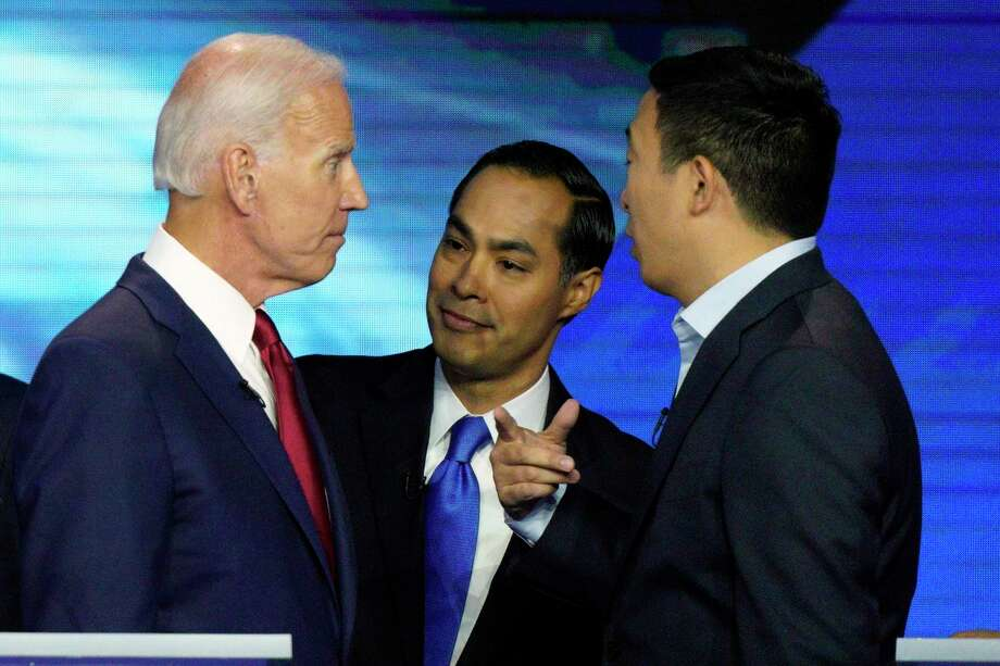 Democratic presidential candidates former Vice President Joe Biden, former Housing and Urban Development Secretary Julian Castro, and Andrew Yang talk Thursday, Sept. 12, 2019, after a Democratic presidential primary debate hosted by ABC at Texas Southern University in Houston. (AP Photo/David J. Phillip) Photo: David J. Phillip, STF / Associated Press / AP