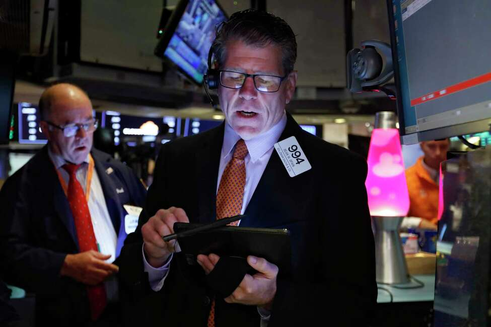 Trader Sean Spain works on the floor of the New York Stock Exchange, Friday, Sept. 13, 2019. Stocks are having a mixed performance early on Wall Street Friday as gains in banks and energy companies are offset somewhat by a drop in technology stocks. (AP Photo/Richard Drew)