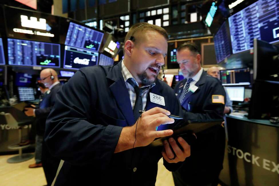 Trader Michael Milano works on the floor of the New York Stock Exchange, Friday, Sept. 13, 2019. U.S. stocks gave a mixed performance in early trading on Friday as health care, banks and industrial companies gained ground and offset a decline in technology stocks. (AP Photo/Richard Drew)