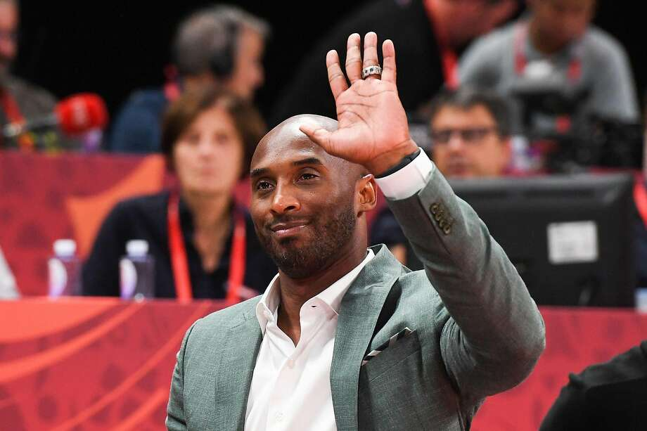 Former U.S. player and NBA great Kobe Bryant waves to the crowd in Beijing Friday. Photo: Greg Baker / AFP / Getty Images
