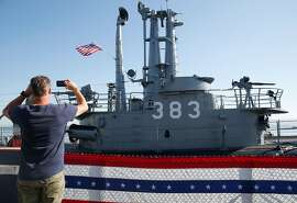 A visitor snaps a picture of the World War II submarine USS Pampanito at Pier 45 in San Francisco, Calif. on Friday, Sept. 13, 2019. The Pampanito rescued 73 prisoners of war left for dead after the Japanese ship they were aboard was torpedoed 75-years ago.