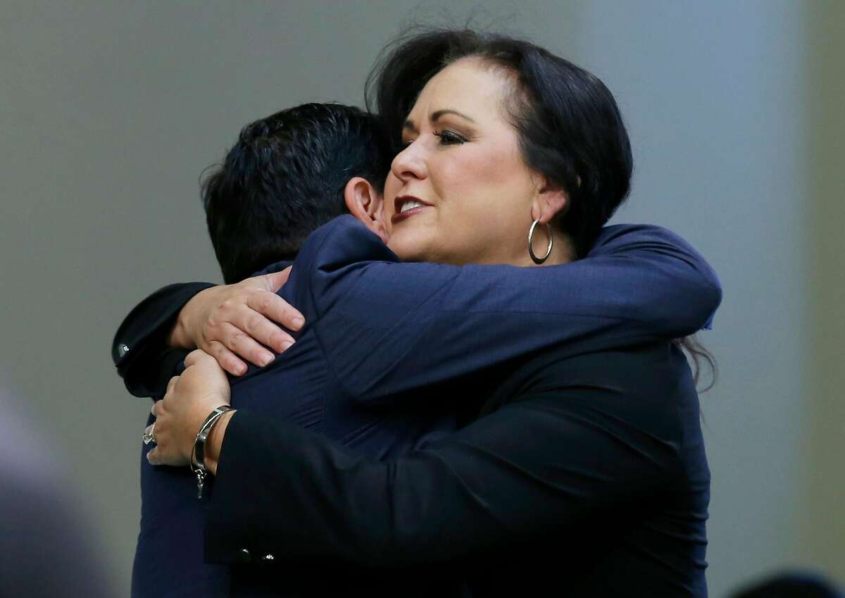 Assemblywoman Lorena Gonzalez, D-San Diego, receives congratulations from Assembly Speaker Anthony Rendon, of Lakewood after her bill to give new wage and benefit protections at the so-called gig economy companies like Uber and Lyft was approved by the Assembly in Sacramento, Calif., Wednesday, Sept. 11, 2019. The bill now goes to the governor, who has said he supports it. (AP Photo/Rich Pedroncelli)