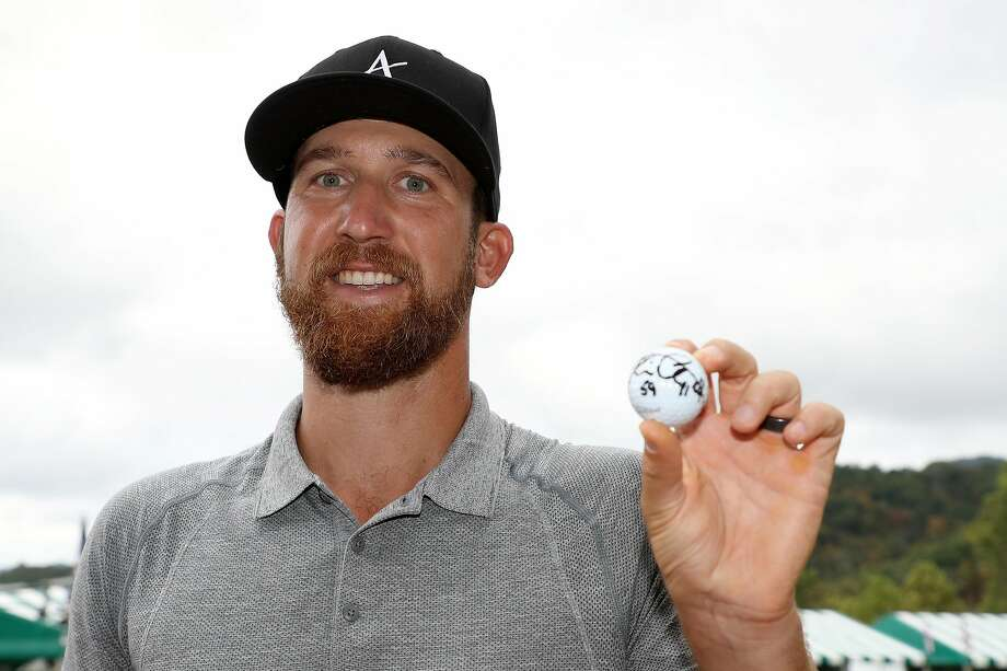 Kevin Chappell poses with his signed ball after shooting the 11th sub-60 round — a 59 — in PGA Tour history. Photo: Rob Carr / Getty Images