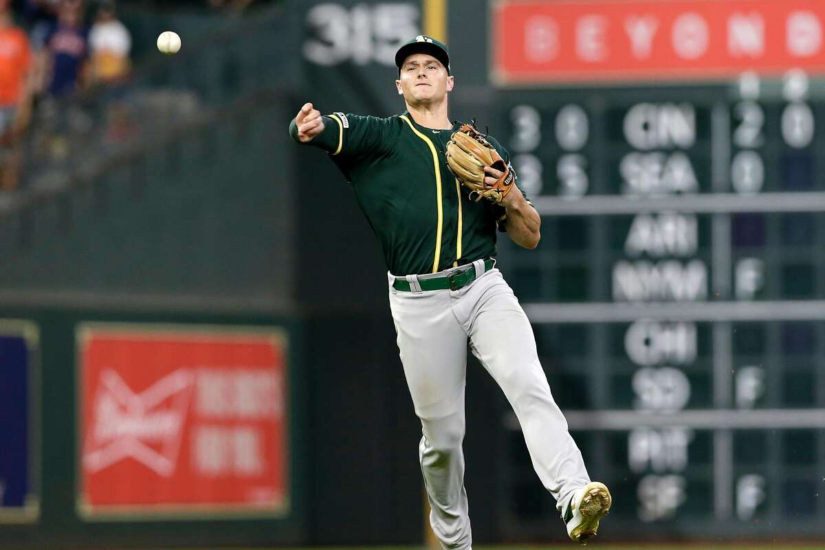 HOUSTON, TX - SEPTEMBER 12: Matt Chapman #26 of the Oakland Athletics throws to first for an out in the eighth inning against the Houston Astros at Minute Maid Park on September 12, 2019 in Houston, Texas. (Photo by Tim Warner/Getty Images)
