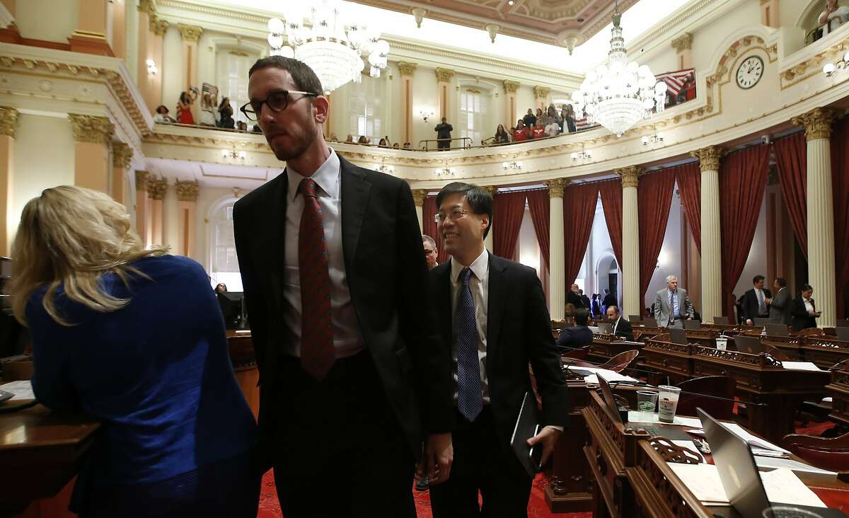State Sen. Richard Pan, D-Sacramento, center, and other members of the Senate leave the Senate Chambers as opponents of Pan's recently passed legislation, SB276, to tighten the rules on giving exemptions for vaccinations demonstrate in the gallery at the Capitol in Sacramento, Calif., Monday, Sept. 9, 2019. Earlier the Assembly had approved SB714, a companion bill to SB276 with changes demanded by Gov Gavin Newsom as a condition of signing the controversial vaccine bill which was passed by the Legislature last week. SB714 still needs to be voted on by the Senate.(AP Photo/Rich Pedroncelli)
