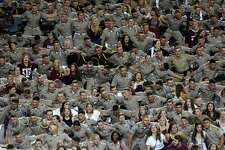 Texas A&M students sway during the playing of the school song in the fourth quarter of the NCAA game against the Northwestern State Demons at Kyle Field Thursday, Aug. 30, 2018, in College Station, Texas. The Aggies won 59-7.