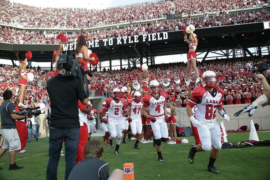 The Lamar Cardinals take the field against Texas A&M Saturday at Kyle Field in College Station, TX. (Matt Billiot / Special to the Enterprise) Photo: Matt Billiot