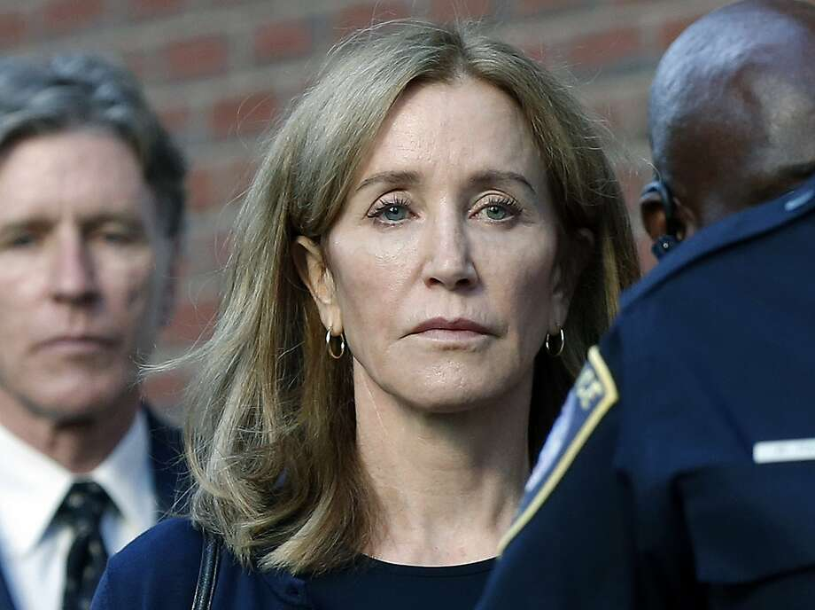Felicity Huffman leaves federal court with her brother Moore Huffman Jr. following, after she was sentenced in a nationwide college admissions bribery scandal, Friday, Sept. 13, 2019, in Boston. (AP Photo/Michael Dwyer) Photo: Michael Dwyer / Associated Press