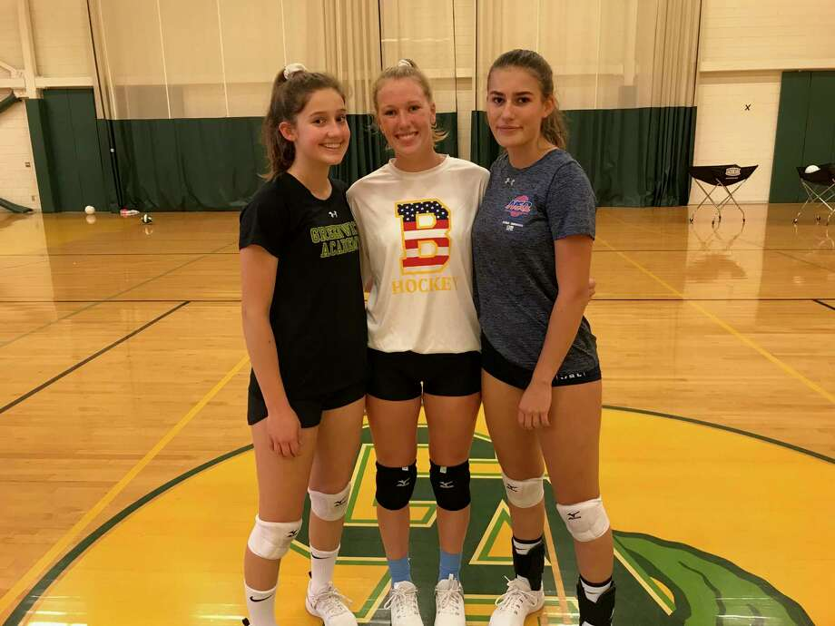 From left to right, Megan Belcastro, Catherine Burns and Valeska Lasky are captains of the Greenwich Academy volleyball team. Photo: David Fierro / Hearst Connecticut Media
