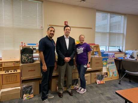 Pictured from left are Roy Reyes, Communities in Schools of Houston, school support manager, Housman Elementary; Jay Sartain, managing director, RBC Capital Markets; and Lindy Robertson, principal, Housman Elementary.