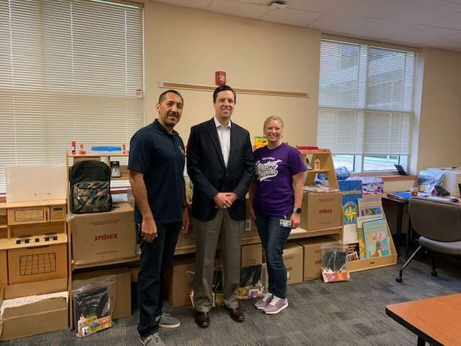 Pictured from left are Roy Reyes, Communities in Schools of Houston, school support manager, Housman Elementary; Jay Sartain, managing director, RBC Capital Markets; and Lindy Robertson, principal, Housman Elementary. Photo: Courtesy Photo