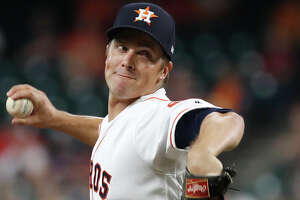 Houston Astros starting pitcher Zack Greinke (21) pitches during the first inning of an MLB baseball game at Minute Maid Park, Monday, Sept. 9, 2019, in Houston.