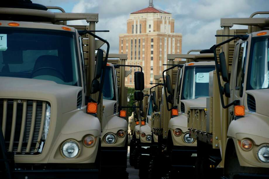 Military trucks line a lot at the Port of Beaumont before being loaded onto the cargo ship Endurance to be shipped to Europe on Tuesday. More than 2,500 pieces of equipment are being prepared for the shipment.  Photo taken Tuesday 8/22/17 Ryan Pelham/The Enterprise Photo: Ryan Pelham / Ryan Pelham/The Enterprise / ©2017 The Beaumont Enterprise/Ryan Pelham