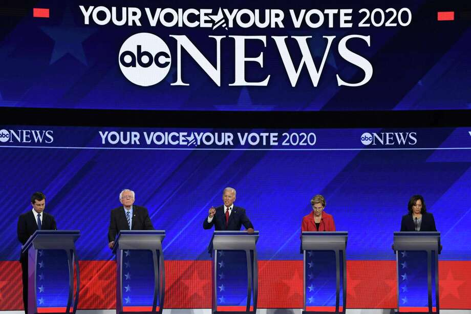 TOPSHOT - Democratic presidential hopefuls (L-R) Mayor of South Bend, Indiana, Pete Buttigieg, Senator of Vermont Bernie Sanders, Former Vice President Joe Biden, Senator of Massachusetts Elizabeth Warren and Senator of California Kamala Harris speak during the third Democratic primary debate of the 2020 presidential campaign season hosted by ABC News in partnership with Univision at Texas Southern University in Houston, Texas on September 12, 2019. (Photo by Robyn BECK / AFP)ROBYN BECK/AFP/Getty Images Photo: ROBYN BECK, Contributor / AFP/Getty Images / AFP