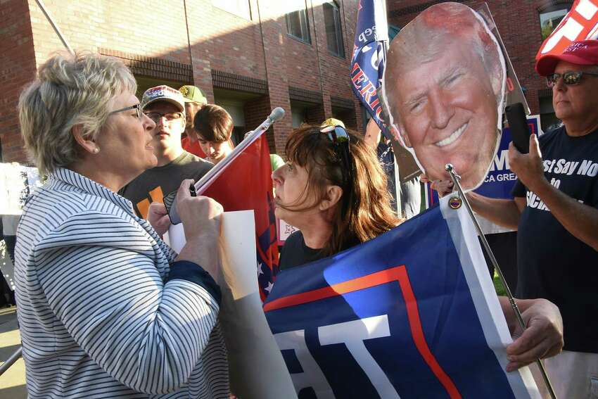 Protestors who were marching in a Stefanik: Defund Hate! March & Rally, left, are confronted by President Donald Trump supporters outside of Elise Stefanik's office on Friday, Sept. 13, 2019 in Glens Fall, N.Y. The protestors were marching in a Stefanik: Defund Hate! March & Rally. Supporters of President Donald Trump confronted the marchers. (Lori Van Buren/Times Union)