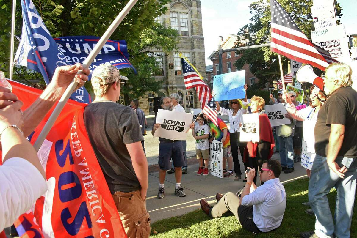 Supporters of President Donald Trump, left, confront protestors who were marching in a Stefanik: Defund Hate! March & Rally outside of Elise Stefanik's office on Friday, Sept. 13, 2019 in Glens Fall, N.Y.(Lori Van Buren/Times Union)