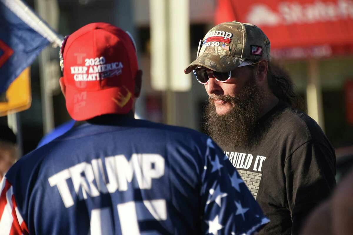 President Donald Trump supporter David Van Scoy, right, talks to other Trump supporters a traffic circle on Friday, Sept. 13, 2019 in Glens Fall, N.Y. The Trump supporters were waiting for protestors marching in a Stefanik: Defund Hate! March & Rally. Supporters of President Donald Trump, left, confronted the marchers. (Lori Van Buren/Times Union)