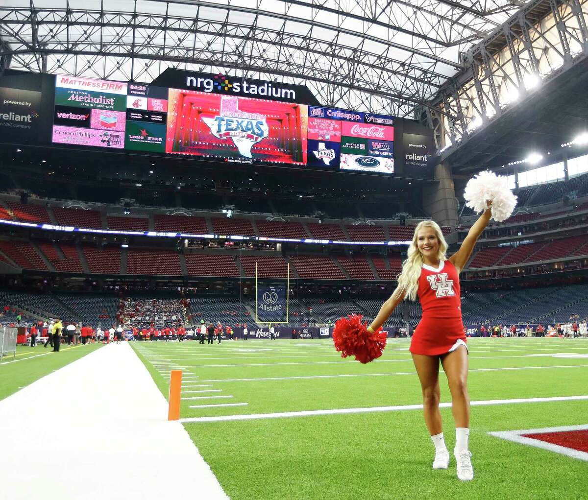 Houston Cougars cheerleaders pose for photos on the field before the start of the AdvoCare Texas Kickoff game at NRG Stadium, Friday, Sept. 13, 2019, in Houston.