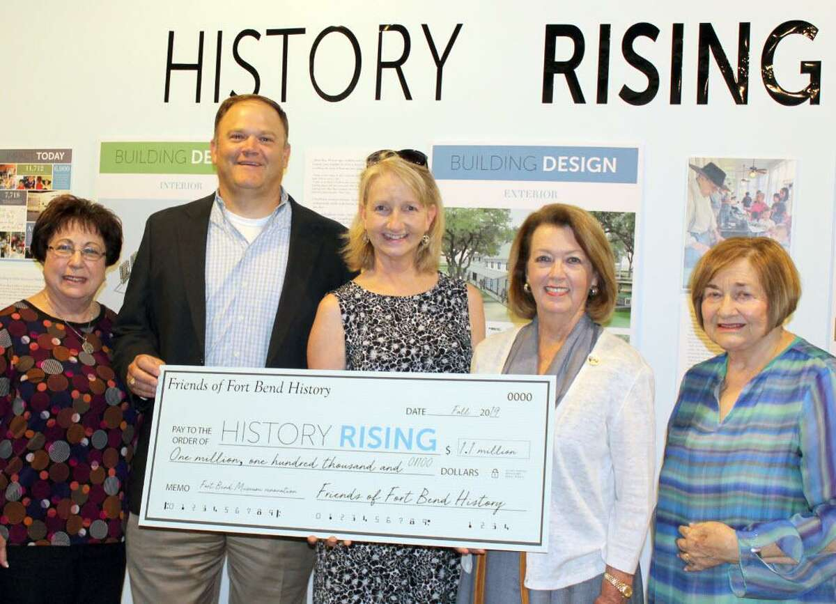 """The Fort Bend History Association announces that """"History Rising,"""" a special project to renovate the Fort Bend Museum's building and exhibit space, has raised more than $1.1 million - more than halfway to the $2 million goal. From left areKay Danziger, a board member for Lamar CISD and the Fort Bend History Association;Roger Adamson, CEO of The George Foundation;Claire Rogers, executive director of the Fort Bend History Association;Mayor Evalyn Moore, daughter of leadership donor and Fort Bend Museum Docent Billie H. Wendt;Mary Jane Kocurek, retired Lamar CISD teacher/librarian, Fort Bend Museum Docent and board member for the Fort Bend History Association."""