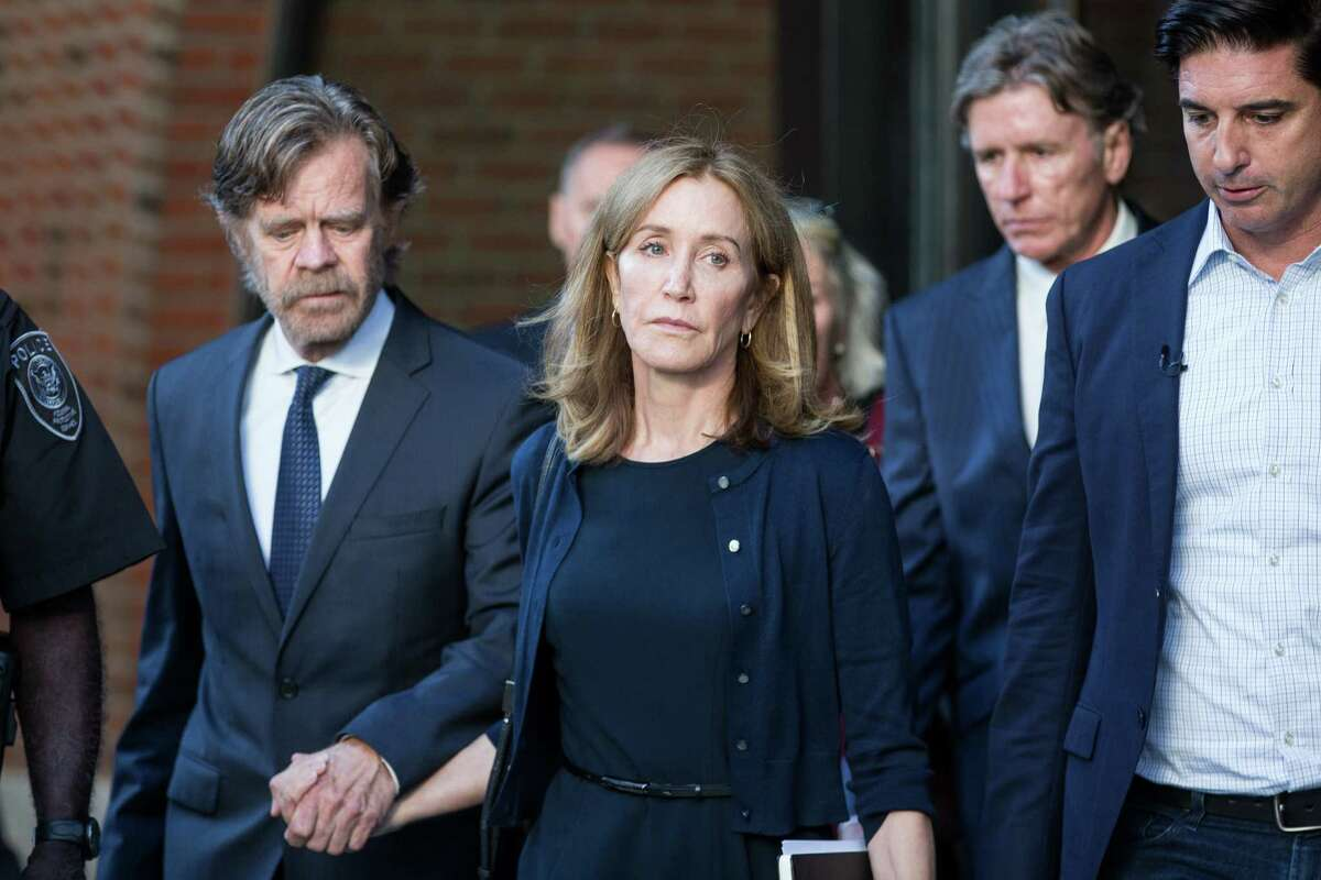 The actress Felicity Huffman leaves federal court beside her husband, the actor William Macy, after her sentencing in Boston, on Friday, Sept. 13, 2019. Huffman was sentenced to 14 days in prison for paying a college consultant $15,000 to inflate her daughtera€™s SAT score, becoming the first parent given a punishment in a sweeping scheme in which nearly three dozen wealthy parents are accused of using lies and bribes to smooth their childrena€™s way into prestigious colleges. (Scott Eisen/The New York Times)