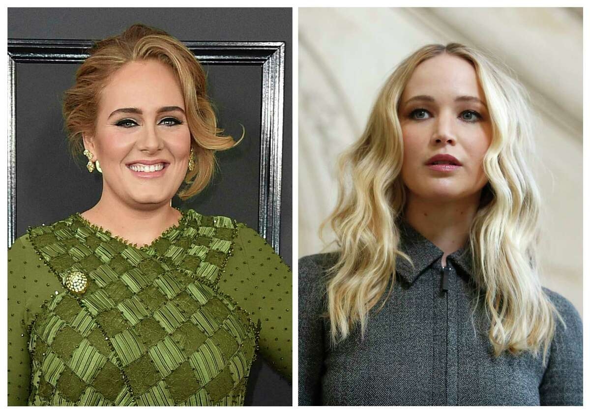 This combination photo shows singer Adele at the 59th annual Grammy Awards in Los Angeles on Feb. 12, 2017, left, and actress Jennifer Lawrence at the Dior ready to wear Fall-Winter 2019-2020 collection in Paris on Feb. 26, 2019. Patrons of the gay bar called Pieces in New York's Greenwich Village were in the right place at the right time when Adele and Lawrence showed up Friday night, March 22, 2019. They drank and danced and schmoozed, hugging shirtless men and taking selfies while the crowd applauded. (AP Photo, File)