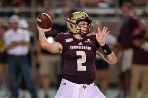 Texas State quarterback Gresch Jensen throws during an NCAA football game against Wyoming on Saturday, Sept. 7, 2019 in San Marcos, Texas. Wyoming won 23-14. (AP Photo/Darren Abate)