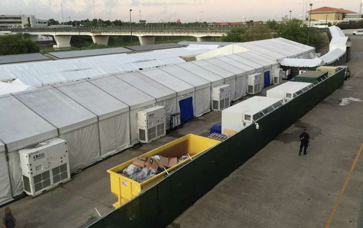 The tents set up in Laredo, Tx., where migrants seeking asylum are taken for a court hearing through live video stream with an immigration judge in San Antonio. Migrants are escorted to the holding tents though an enclosed walkway, at top right, leading from the U.S. side of the Gateway to the Americas International Bridge.