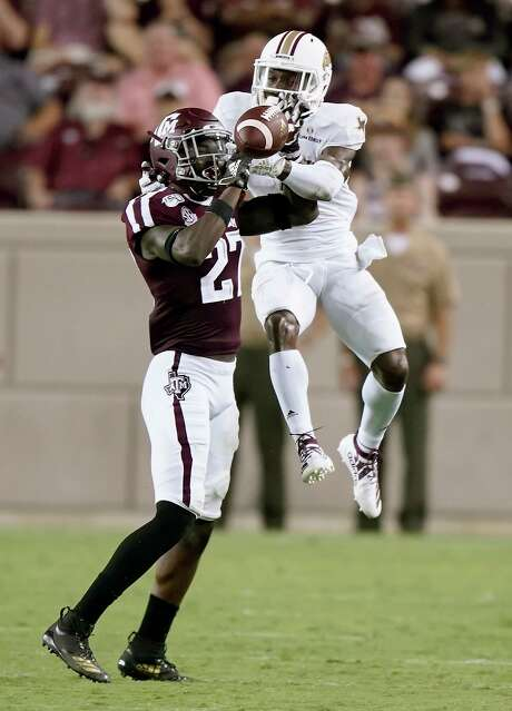 Roney Elam, left, has been a key player for Texas A&M early this season with two interceptions and a sack.