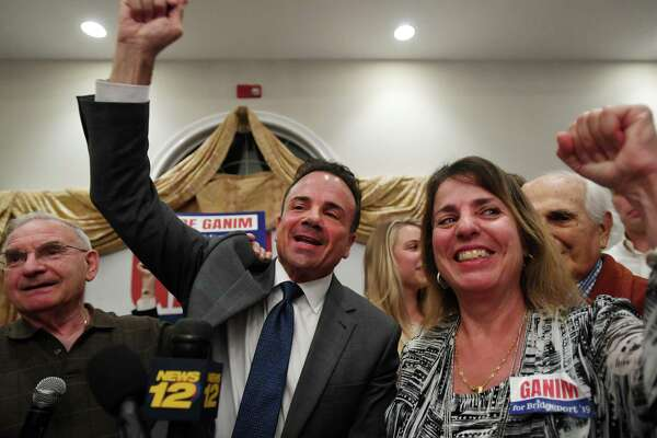 Bridgeport Mayor Joe Ganim celebrates his victory in the Bridgeport Democratic mayoral primary with his sister Roseanne Ganim, right, at Testo's Restaurant in Bridgeport, Conn. on Tuesday, September 10, 2019. At left is Democratic Town Committee Chairman Mario Testa.