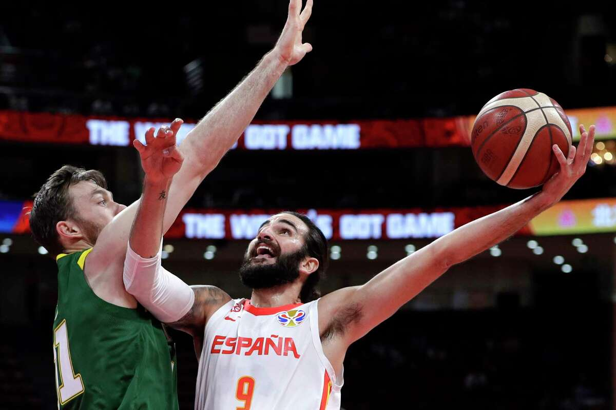 Ricky Rubio of Spain puts up a shot against Nick Kay of Australia during their semifinal match in the FIBA Basketball World Cup at the Cadillac Arena in Beijing, Friday, Sept. 13, 2019. (AP Photo/Mark Schiefelbein)