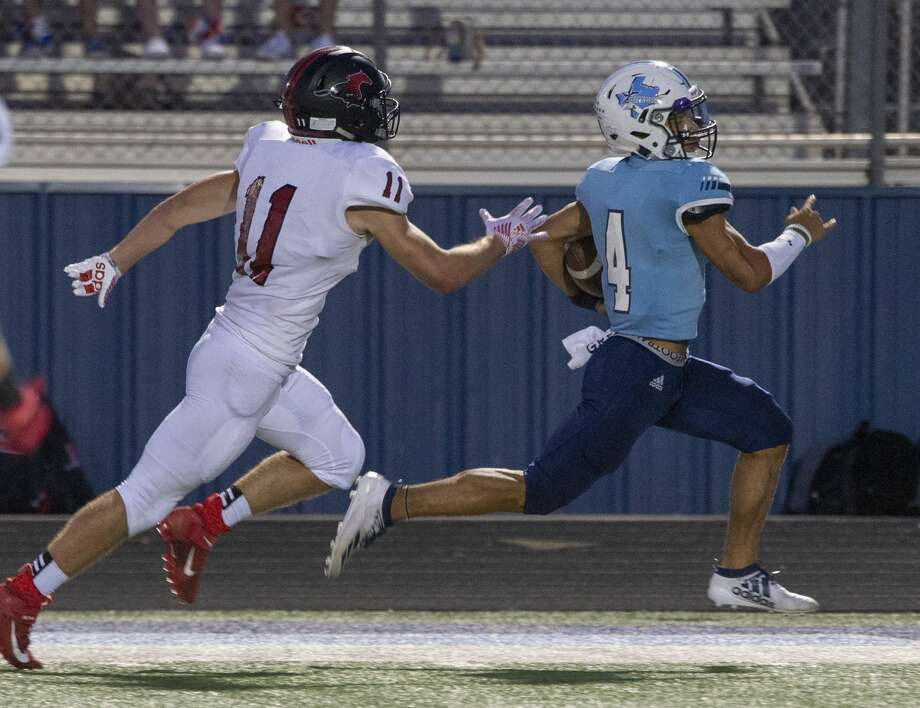 Greenwood's Trey Cross runs down the sideline away from Shallowater's Kreed Kotara and the rest of the team on the way to a touchdown 09/13/19 at J.M. King Memorial Stadium. Tim Fischer/Reporter-Telegram Photo: Tim Fischer/Midland Reporter-Telegram