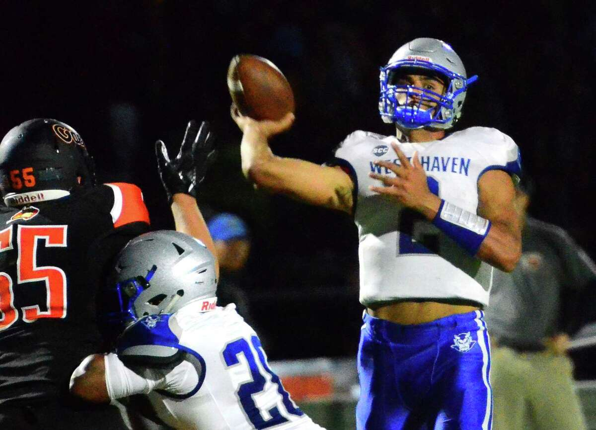 West Haven QB Andre Rentas passes the ball during football action against Shelton in Shelton, Conn., on Friday Sept. 13, 2019.