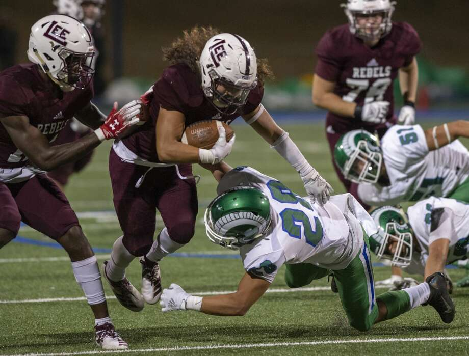Lee's Ryan Quiroz is tackled by El Paso Montwood's Khalid Andha (28) on Friday, Sept. 13, 2019 at Grande Communications Stadium. Photo: Jacy Lewis/Reporter-Telegram