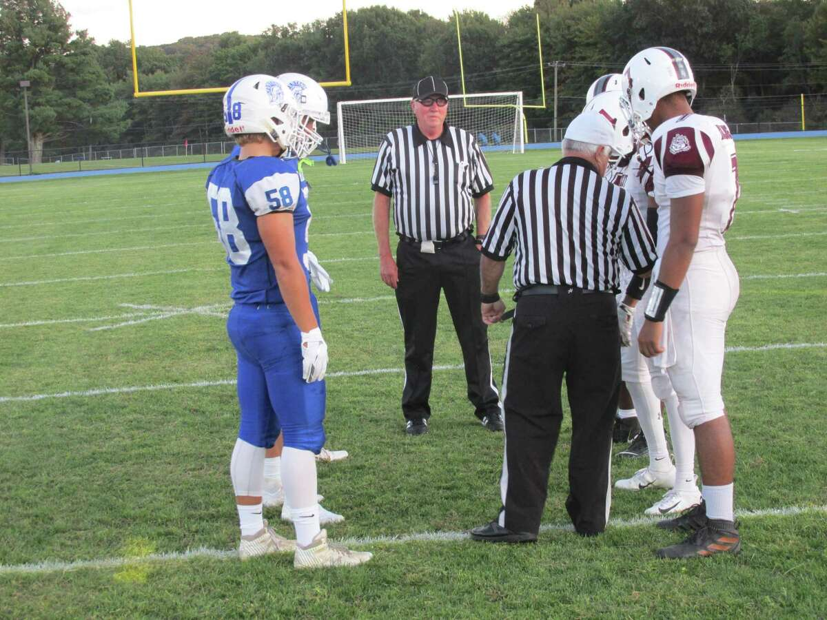 The Lewis Mills defense took charge soon after the coin toss in a big opening win for Lewis Mills Friday night at Lewis Mills High School.