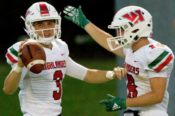 The Woodlands quarterback Peyton Janecek (3) reacts after scoring a touchdown during the second quarter of a District 15-6A high school football game at Buddy Moorhead Stadium, Friday, Sept. 13, 2019, in Conroe.