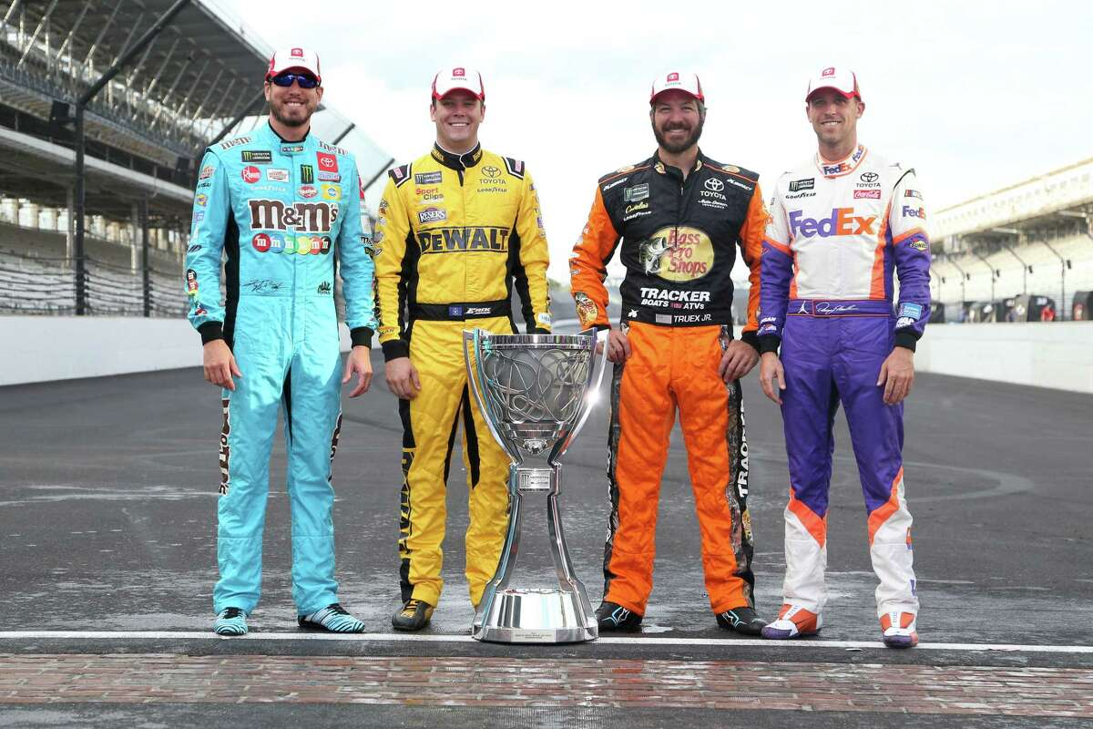 INDIANAPOLIS, INDIANA - SEPTEMBER 08: Kyle Busch, driver of the #18 M&M's Toyota, Erik Jones, driver of the #20 STANLEY Wish For Our Heros Toyota, Martin Truex Jr, driver of the #19 AOI Toyota, and Denny Hamlin, driver of the #11 FedEx Express Toyota, pose for a photo to start the Monster Energy NASCAR Cup Series Playoffs after the Monster Energy NASCAR Cup Series Big Machine Vodka 400 at the Brickyard at Indianapolis Motor Speedway on September 08, 2019 in Indianapolis, Indiana. (Photo by Brian Lawdermilk/Getty Images)