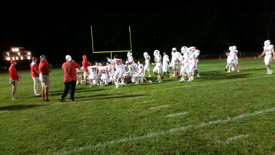 Fairfield Prep gathers for a postgame huddle after beating North Haven 14-7 in a football game on Sept. 12, 2019, at Vanacore Field. Photo: Michael Fornabaio / Hearst Connecticut Media