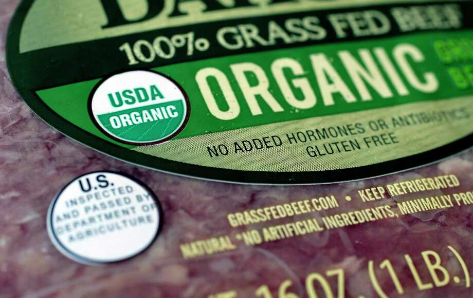 "FILE - In this July 9, 2018 photo a ""USDA Organic"" label is printed on the label of a pound of ground beef, in Walpole, Mass. Labels such as a€œFair Trade Certified a€ or a€œUSDA Organica€ signify that a producta€™s supply chain has gone through some level of vetting. However, standards can vary widely. (AP Photo/Steven Senne, File) Photo: Steven Senne / Copyright 2018 The Associated Press. All rights reserved."