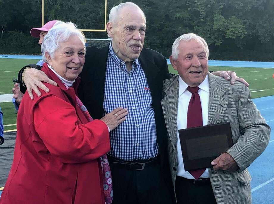 The Bunnell Athletic Department honored the Wojnarowski family and longtime former football and softball coach Bob Mastroni Friday night, Sept. 13, 2019. From left, Arlene Wojnarowski, Jack Wojnarowski and Bob Mastroni. Photo: By Will Aldam / For Hearst Connecticut Media