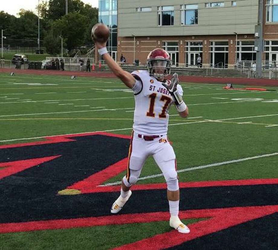 Jack Wallace threw for five touchdowns in his first varsity start at quarterback for St. Joseph on Friday. Photo: Bill Bloxsom / Hearst Connecticut Media / Trumbull Times