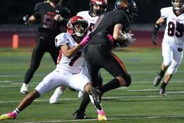 Glens Falls defensive back Aalijah Sampson tackles Schuylerville wide receiver Evan Jeffords during a game Friday night in Schuylerville. (Jenn March, Special to the Post-Star)
