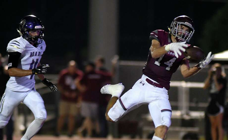 Magnolia senior wide receiver Ben Renfro, right, finishes a catch for a touchdown against Montgomery sophomore cornerback Logan Scott, left, on a pass from Bulldogs junior quarterback Travis Moore in the second quarter of their matchup at Magnolia Stadium on Friday, Sept. 13, 2019. Photo: Jerry Baker, Houston Chronicle / Contributor / Houston Chronicle