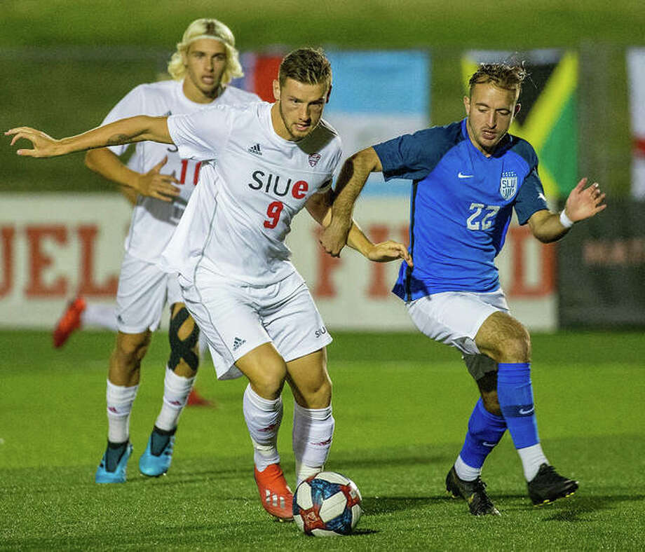 SIUE's Lachlan McLean (9) battles a Saint Louis U player for possession of the ball Friday in the annual Bronze Boot game at Korte Stadium. Saint Louis U. won in double overtime, 2-1. Photo: Scott Kane, SIUE | For The Telegraph