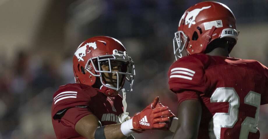 North Shore defensive back's Jordan Polart (4) and Denver Harris (22) celebrate after Harris knocked away a Katy pass in the end zone during the second half of a high school football game at Galena Park ISD Stadium on Thursday, Aug 29, 2019, in Houston. Photo: Joe Buvid/Contributor