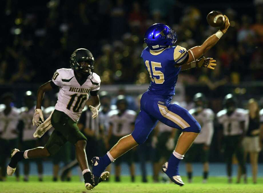 Hamshire Fannett's Kyle Saurage attempts to catch the ball against East Chambers at the Longhorn's stadium Friday night. Photo taken Friday, 9/13/19 Photo: Guiseppe Barranco/The Enterprise, Photo Editor / Guiseppe Barranco ©