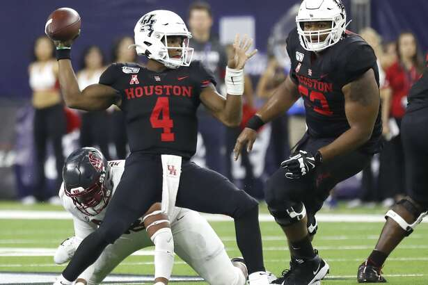 Houston Cougars quarterback D'Eriq King (4) looks to pass the ball in the first half of the AdvoCare Texas Kickoff game at NRG Stadium, Friday, Sept. 13, 2019, in Houston.