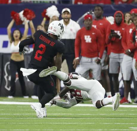 Houston Cougars wide receiver Keith Corbin (2) gains yardage against Washington State Cougars cornerback George Hicks III (18) of the AdvoCare Texas Kickoff game at NRG Stadium, Friday, Sept. 13, 2019, in Houston.